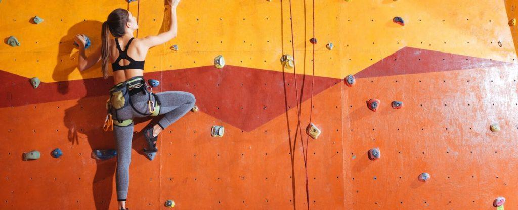 Woman rock climbing at the Rock Dump in Juneau