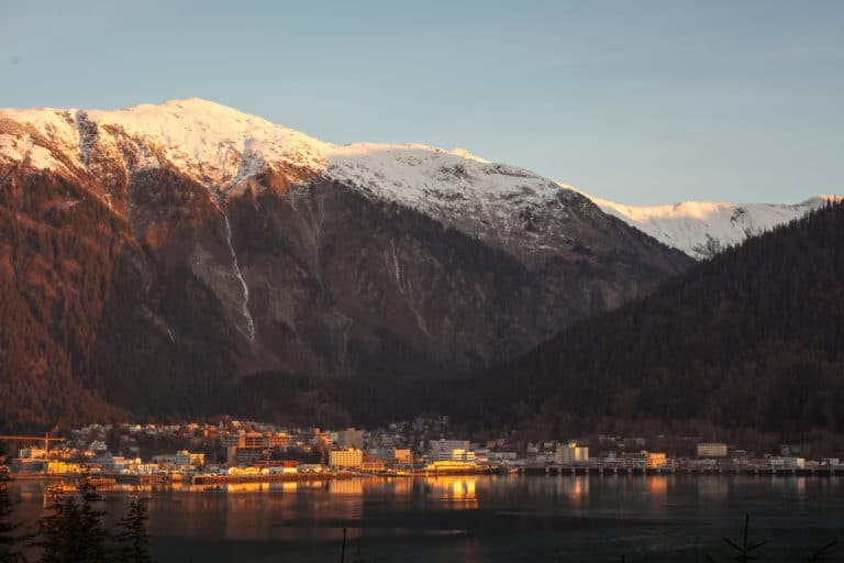A stunning view of Mountain Juneau hiking trails, as it towers behind downtown Juneau