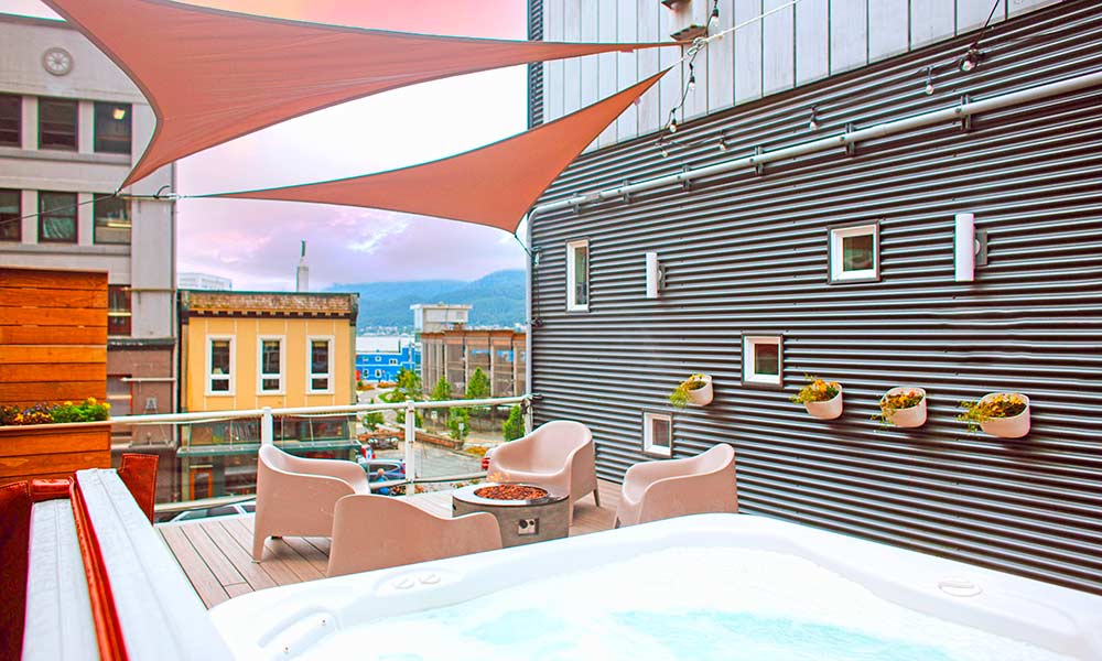 relax in our rooftop hot tub after a fun day of mountain biking near downtown Juneau